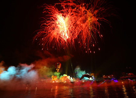 an entertainer: KRAKOW, POLAND - JUNE 4, 2016:  Yearly Great Dragons Parade connected with the fireworks display, taking place on the river Vistula at Wawel. Cracow , Poland