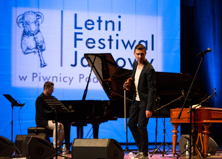 solo violinist: CRACOW, POLAND - JUNE 11, 2016: Adam Baldych -  Polish violinist  playing live music at Summer Jazz Festival in Cracow, Poland Editorial
