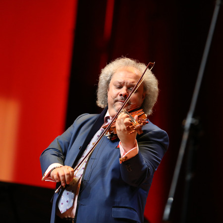 solo violinist: CRACOW, POLAND - JUNE 11, 2016: Roby Lakatos  Romani violinist from Hungary  playing live music at Summer Jazz Festival in Cracow, Poland