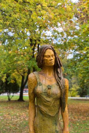 genie woman: Fairy-like wooden figures from primaeval Slawic tales by Grzegorz Michalek