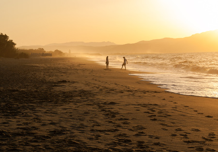 footsteps: beach, wave and footsteps at sunset time