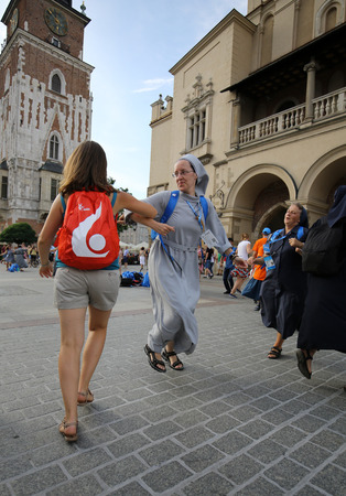 cracow: CRACOW, POLAND - JULY 24, 2016: Pilgrims of World Youth Day sing and dance on the Main Square in  Cracow. Poland