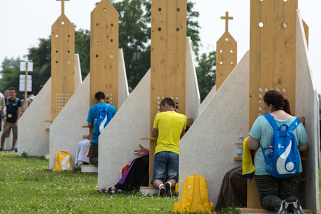 reconciliation: CRACOW, POLAND -  JULY 26, 2016: Pilgrims in Zone of Reconciliation at Sanctuary of Divine Mercy in Lagiewniki. WYD participants will be able to confess to more than 50 confessionals. Cracow Poland