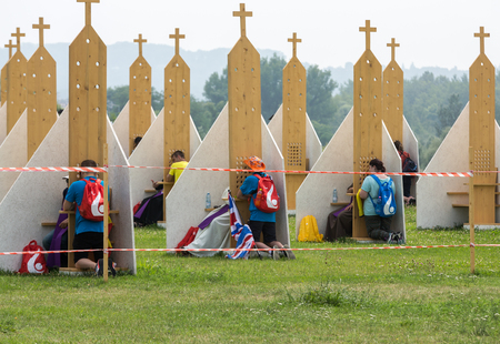 confess: CRACOW, POLAND -  JULY 26, 2016: Pilgrims in Zone of Reconciliation at Sanctuary of Divine Mercy in Lagiewniki. WYD participants will be able to confess to more than 50 confessionals. Cracow Poland
