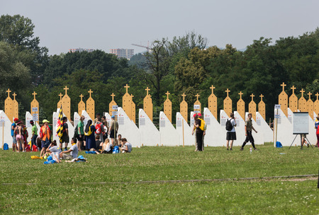 christian youth: CRACOW, POLAND -  JULY 26, 2016: Pilgrims in Zone of Reconciliation at Sanctuary of Divine Mercy in Lagiewniki. WYD participants will be able to confess to more than 50 confessionals. Cracow Poland