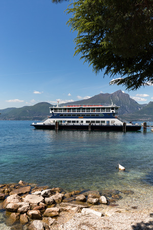 frequented: Ferry boat on  Lake Garda. Garda Lake is one of the most frequented tourist regions of Italy. Editorial