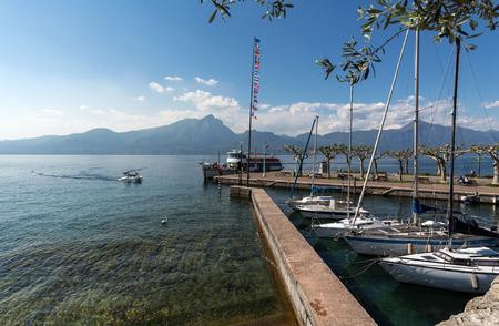 torri: boats in the small harbor of Torri del Benaco. Garda Lake. Italy
