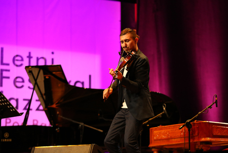 cracow: CRACOW, POLAND - JUNE 11, 2016: Adam Baldych -  Polish violinist  playing live music at Summer Jazz Festival in Cracow, Poland Editorial