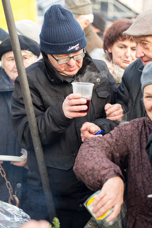 CRACOW, POLAND - DECEMBER 20, 2015:  Christmas Eve for poor and homeless on the Central Market in Cracow. Every year the group Kosciuszko prepares the greatest eve in the open air in Poland