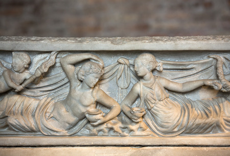 funerary: Bas-relief on the ancient sarcophagus in the baths of Diocletian in Rome. Italy