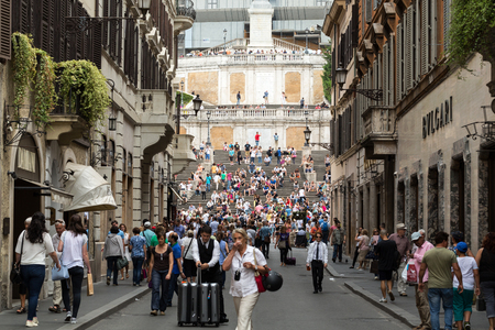 prada: ROME, ITALY - JUNE 15, 2015: Spanish Steps and Via Condotti in Rome. This street is the center of fashion shopping in Rome with the atelier of Bulgari, Armani, Cartier, Fendi, Gucci, Prada and others.