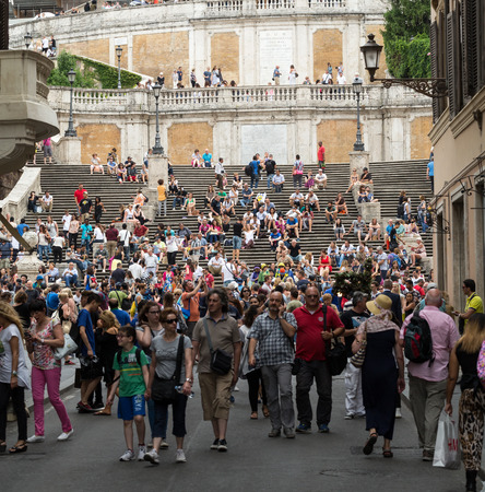 financed: ROME, ITALY -JUNE 15, 2015: Visitors at the Spanish Steps on June 15, 2015 in Rome, Italy.Built in 1723-1725 by a design of the architect Francesco de Sanctis and financed by French diplomat Etienne