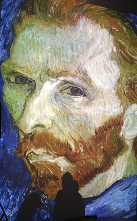 The exhibition Van Gogh Alive – The Experience at The Old Train Station in Krakow. Poland 版權商用圖片 - 64722791