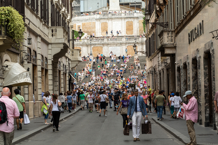 ROME, ITALY - JUNE 15, 2015: Spanish Steps and Via Condotti in Rome. This street is the center of fashion shopping in Rome with the atelier of Bulgari, Armani, Cartier, Fendi, Gucci, Prada and others. Stock Photo - 64707496