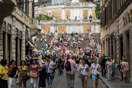 spanish steps: ROME, ITALY -JUNE 15, 2015: Visitors at the Spanish Steps on June 15, 2015 in Rome, Italy.Built in 1723-1725 by a design of the architect Francesco de Sanctis and financed by French diplomat Etienne