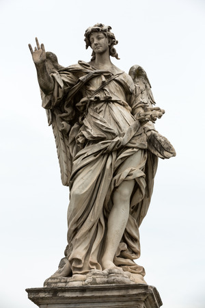 Marble statue of angel from the SantAngelo Bridge in Rome, Italy, designed by Bernini Stock Photo