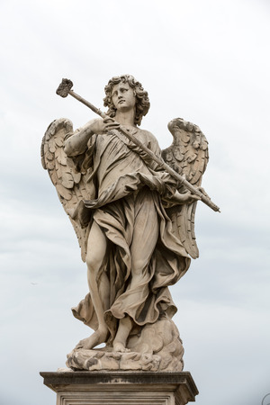 Marble statue of Angel with the Sponge by   Antonio Giorgetti from the SantAngelo Bridge in Rome, Italy, Stock Photo