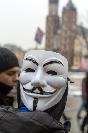 fawkes: CRACOW, POLAND - JANUARY 24, 2016: The political demonstration of anarchists on the Main Square  in Cracow. Poland Editorial