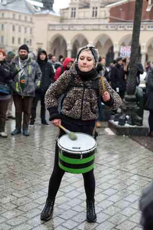 manifest: CRACOW, POLAND - JANUARY 24, 2016: The political demonstration of anarchists on the Main Square  in Cracow. Poland Editorial