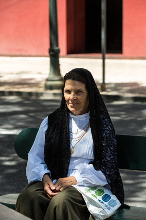 solemnize: FUNCHAL, MADEIRA, PORTUGAL - SEPTEMBER 1, 2016: Madeira Wine Festival - portrait of a womanl in traditional costume  in Funchal on Madeira. Portugal Editorial