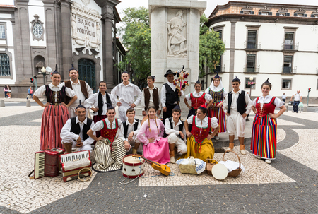 FUNCHAL, PORTUGAL - SEPTEMBER 2, 2015: Dancers with local costumes demonstrating a folk dance during the Wine Festival in Funchal on the Madeira, Portugal. Editorial