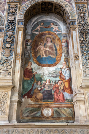 niches: The Madonna with the child by Bonino da Campione in the church of The Eremitani (Chiesa degli Eremitani) on the tomb of Umberto da Carrara. Padua. Italy Editorial