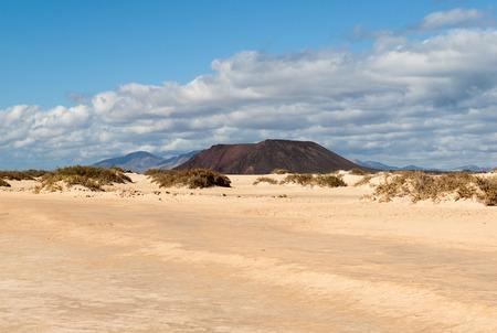 Corralejo sand dunes and extinct volcanoes  in the background. Fuerteventura, Canary Islands, Spain