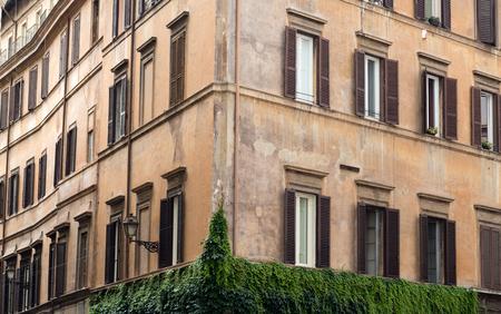 corner of house: Old orange corner house in the center of Rome, Italy
