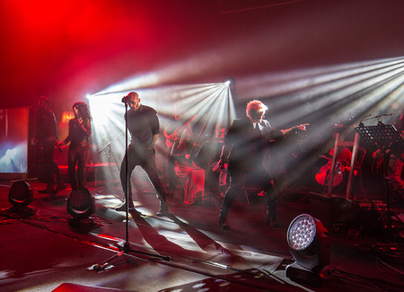 CRACOW, POLAND - NOV EMBER 6, 2016: Symphonica 2 Made in Poland  The music of cult, of underground, rock, metal- and punk Polish groups from years 80-these performed  by musicians and soloists Filharmonia Futura on stage cinemas Kiev in Cracow. Editorial