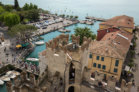 View of colorful old buildings in Sirmione and Lake Garda from Scaliger castle wall, Italy Editorial