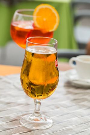 spritz: Traditional Spritz aperitif and beer  in a bar in Italy