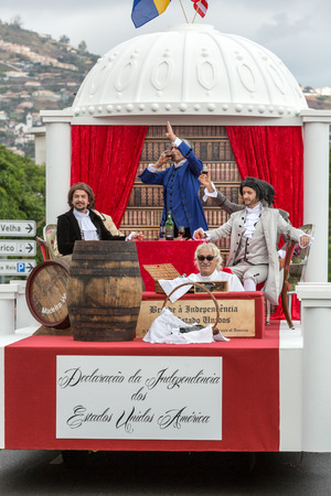 FUNCHAL, MADEIRA, PORTUGAL - SEPTEMBER 4, 2016: Men in historical fashion dress raise toasts durnig historical and ethnographic  parade of Madeira Wine Festival in Funchal. Madeira, Portugal