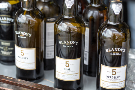 retailers: FUNCHAL, MADEIRA, PORUGAL - SEPTEMBER 3, 2016:  Wine producers encourage to the tasting of their wines during Madeira wine Festival in Funchal on Madeira, Portugal, Editorial