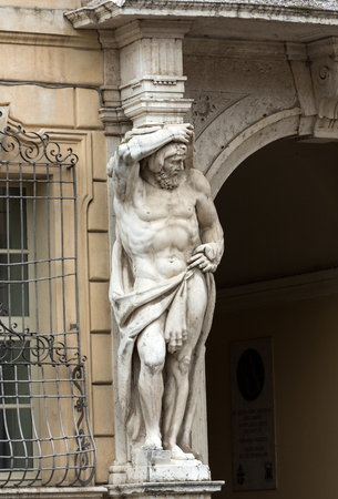 telamon: Statue of Hercules at the entrance to the 18th century Palazzo Vescovile (Bishops Palace) in the historical center of Mantua, Ital