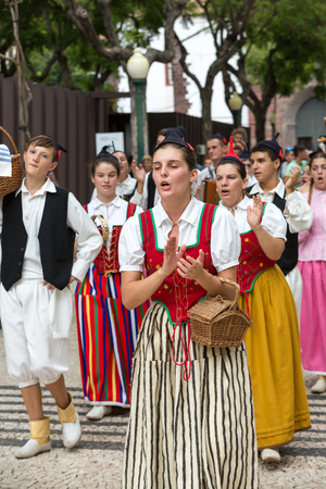 FUNCHAL, PORTUGAL - SEPTEMBER 2, 2016: Dancers with local costumes demonstrating a folk dance during the Wine Festival in Funchal on the Madeira, Portugal.