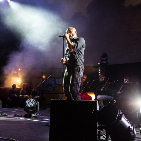 CRACOW, POLAND - NOV EMBER 6, 2016: Symphonica 2 Made in Poland  The music of cult, of underground, rock, metal- and punk Polish groups from years 80-these performed  by musicians and soloists Filharmonia Futura on stage cinemas Kiev in Cracow. Op Damian