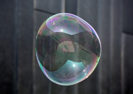 The transparent, iridescent soap bubbles  on black background Stock Photo