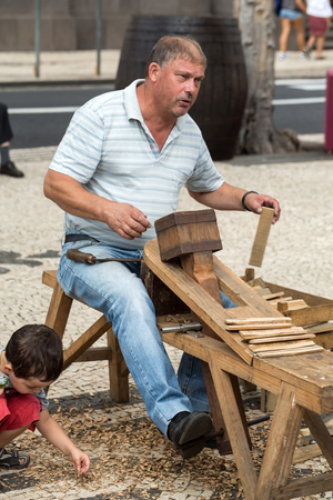 agricultura: FUNCHAL, MADEIRA, PORTUGAL - SEPTEMBER 1, 2016: Barrel Building Demonstration during the Madeira Wine Festival in Funchal on Madeira Island. Portugal