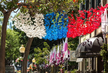 FUNCHAL, MADEIRA, PORTUGAL - SEPTEMBER 1, 2016: Colorful decorations  from garlands over streets during the Madeira Wine Festival in Funchal on Madeira Island. Portugal