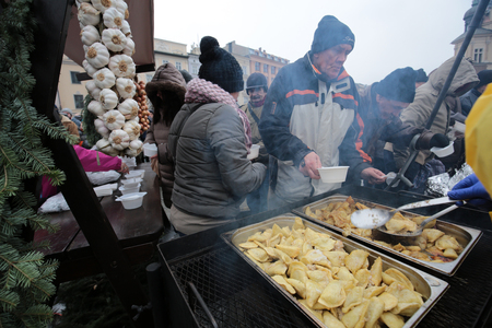 CRACOW, POLAND - DECEMBER 18, 2016:  Christmas Eve for poor and homeless on the Central Market in Cracow. Every year the group Kosciuszko prepares the greatest eve in the open air in Poland Editorial