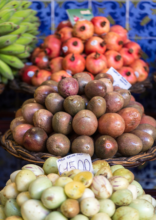 anona: Fresh exotic fruits on famous market in Funchal (Mercado dos Lavradores), Madeira island, Portugal Stock Photo