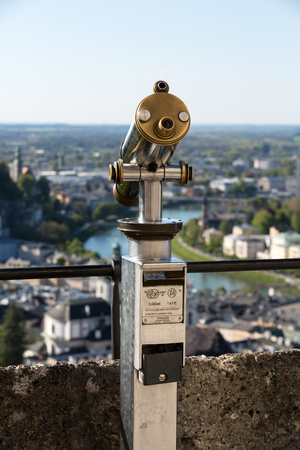monocular: Public monocular telescope (monoscope) on the top of observation deck - view to the historic city center of Salzburg with Salzach river and Alps on background, Salzburger Land, Austria