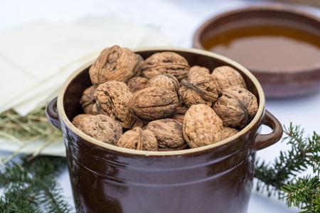 Walnuts in a ceramic pot