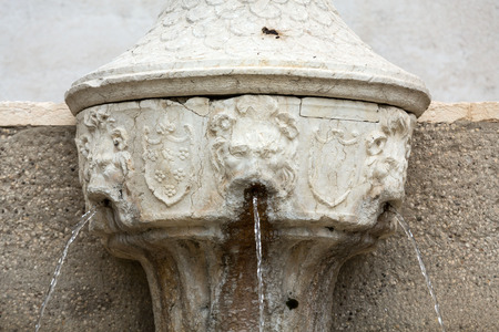 mediaval: Small fountain in Castelvecchio Museum. Verona, Italy Editorial
