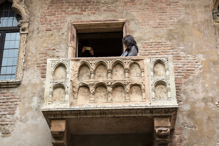 romeo and juliet: Juliet balcony in Verona. Romeo and Juliet is a tragedy written by William Shakespeare. This place is the main tourist attraction in Verona. Stock Photo