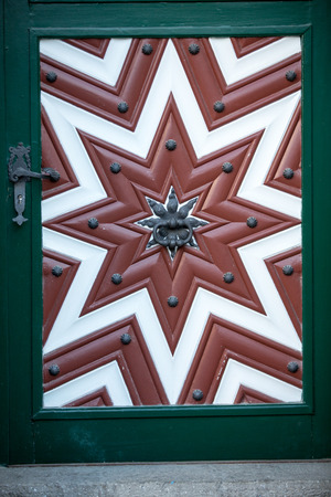 Wooden door in old town of Salzburg. Austria
