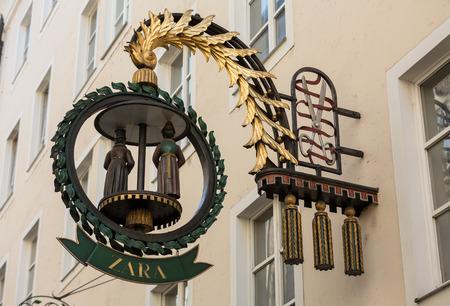 SALZBURG, AUSTRIA - APRIL 29, 2016: Wrought-iron guild sign hanging above a shop on Getreidegasse in Salzburg Editorial