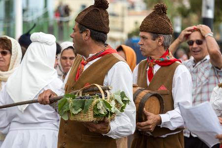 ethnographic: FUNCHAL, PORTUGAL - SEPTEMBER 4, 2016: Group of people in traditional costume  durnig historical and ethnographic  parade of Madeira Wine Festival in Funchal. Madeira, Portugall