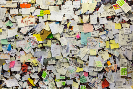 Part of the wall covered with love messages in Juliet house, Verona, Italy