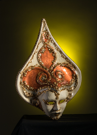 Beuaty Venetian mask isolated on black and yellow background